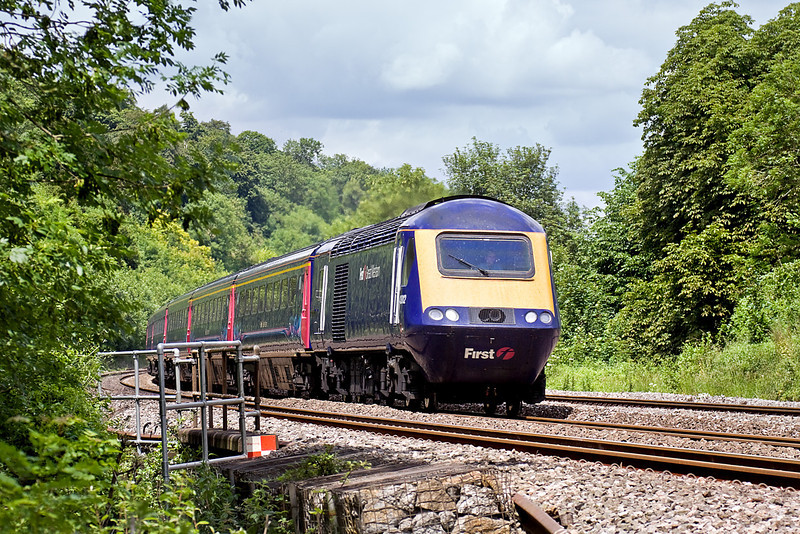 24th Jun 10:  43012 leads on 1A14 the 11.00 from Bristol Temple Meads. Pictured here rushing through the cutting just to the west of Pangbourne
