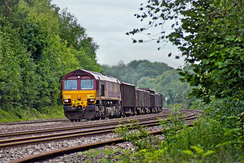 24th Jun 10:  The lunchtime 'Mud Express' from Bow Olympic to Appleford Tip carefully misses the sun as 66031 brings 6V36 away from Pangbourne