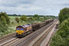 7th Jun 10:  6V36 is the 04.45 loaded spoil boxes fron Bow Olympic to Appleford.  66171 is captured in a little weak sun passing through Shottesbrooke
