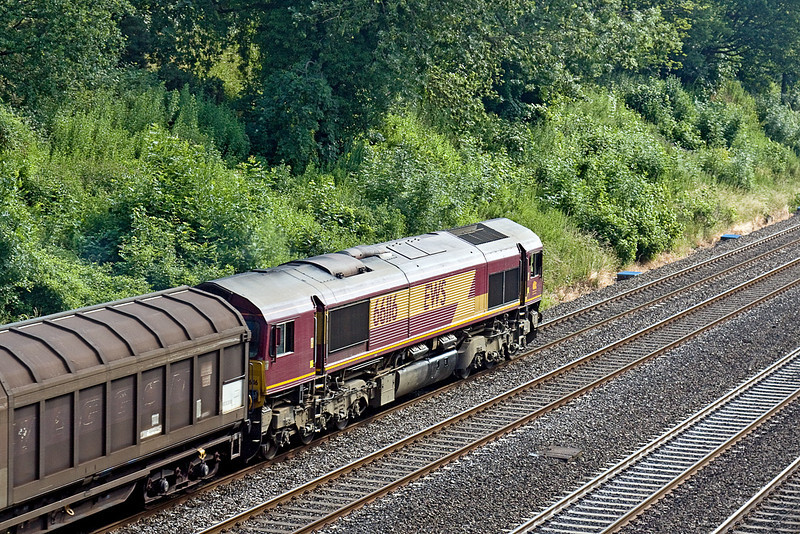 26th Jun 10:  66116 on the point of 6O45 from Didcot to Dollands Moor heads east through the Sonning Cutting