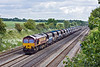7th Jun 10:  66177 at the helm of 6B35 with Bardon Agregates hoppers runs through Shottesbrooke as it makes for Moreton on Lug from Acton