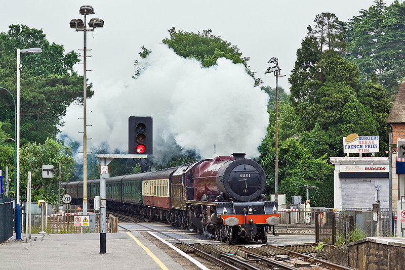 "10th Jun 10:  Going well is it crosses the level crossing over the A30 at Sunningdale is LMS 8P  6201 ""Princess Elizabeth"".  The Cathedrals Express is running from Victoria to Bristol"