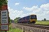 2nd Jun 10:  The 12.37 from Basingstoke to Reading runs north through Grazeley in the hands of 165129