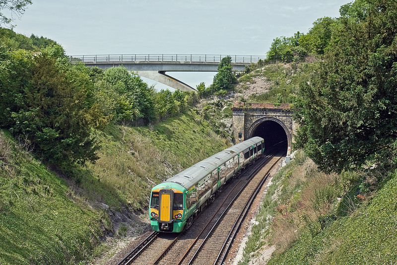 30th Jun 10:  Entering Kingston Tunnel is 377425 on an Ore to Brighton Service.  The bridge in the background carries Juggs Road over the A27