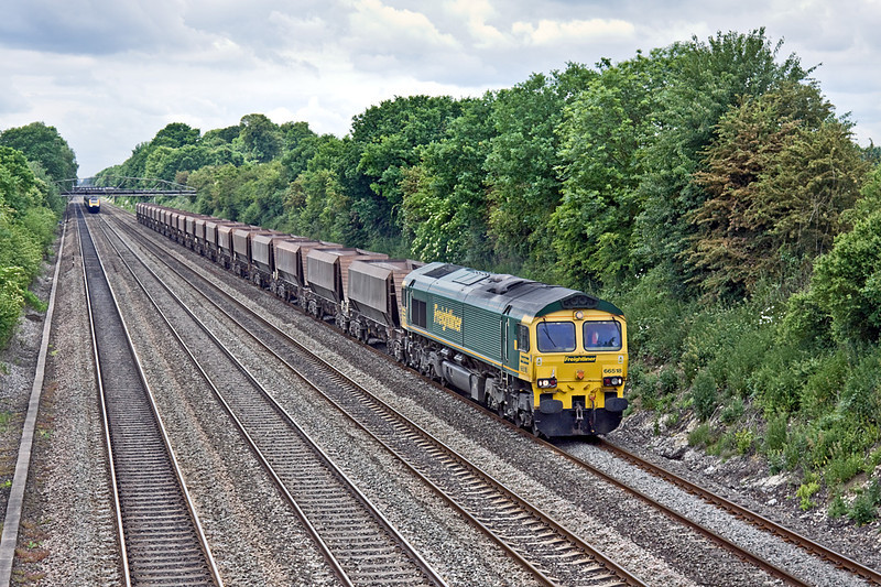 7th Jun 10:  A new flow starting today is 6Z92 taking stone empties from Eastleigh to Croft.  66518 is plodding up the Relief line through Shottesbrooke