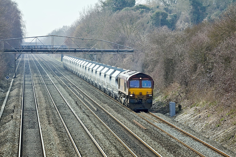 18th Mar 10:  66097 passes under the pipe bridge at Shottesbrooke on the point of 6V36 from Theale to Acton