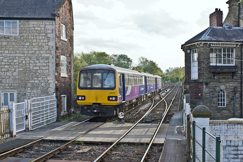 9th May 10:  144016 runs past the unusual Knaresborough Signal Box and onto the famous viaduct as it makes for Leeds with the 17.17 from York