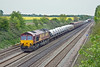 5th May 10:  With a very good load 66144 runs west through Shottesbrooke with Ford vehicles from Daggenham to Didcot