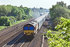 22nd May 10:  66001 in charge of a long rake of car carriers on the Down Main away from Maidenhead