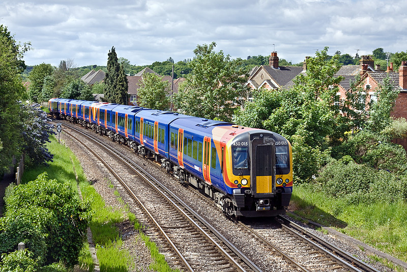 28th May 10:  Approaching Egham are 450015 and 570 working the 10.25 from Weybridge to Waterloo via Hounslow