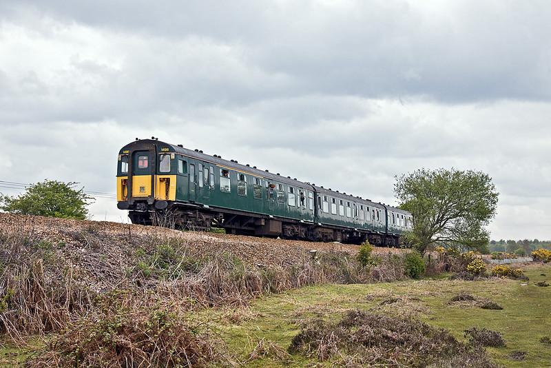20th May 10: 1J29 the 12.44 from Lymington Pier nears Brockenhurst