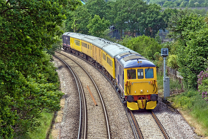 26th May 10:  Running through Camberley on it's way to Ascot is 73212 TnT 73141 working Serco 1Q26,  Starting in Selhurst the train will vist Waterloo, Portsmouth and Alton before returning to Selhurst