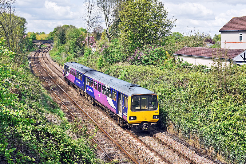 7th May 10:  Running south through Harrogate is the 13.11 from York in the hands of 144008