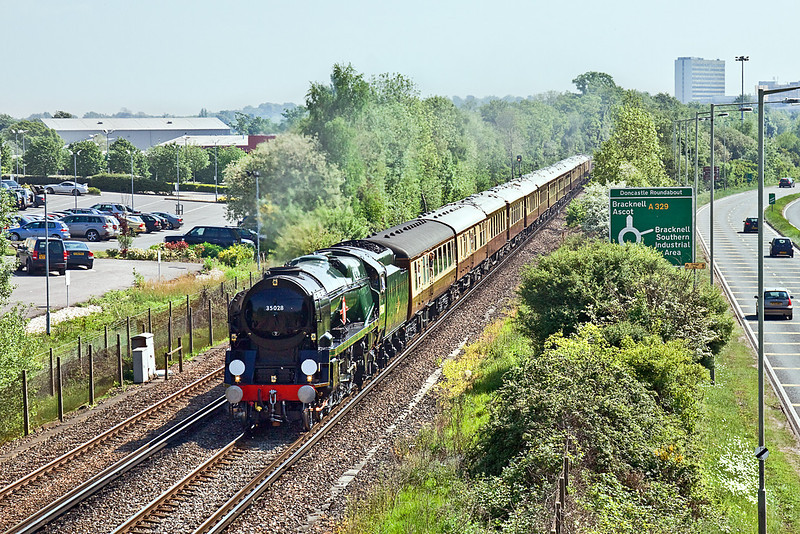 21st May 10:  On a hot and humid May morning 35028 Clan Line runs west away from Bracknell. 1Z27 takes the Orient Express to Oxford from Victoria