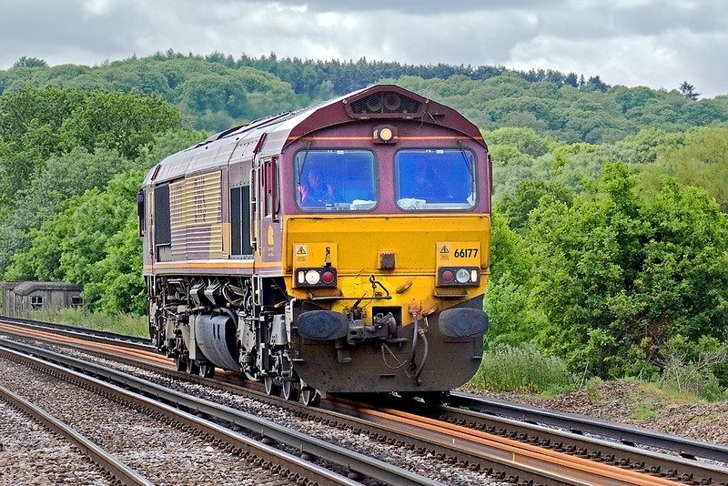 28th May 10:  When you loose the sun and there is nothing on the hook picture options are rather limited.  66177 as 0Y41 Eastleigh to Hoo Junction Departmental nears Prune Hill in Egham