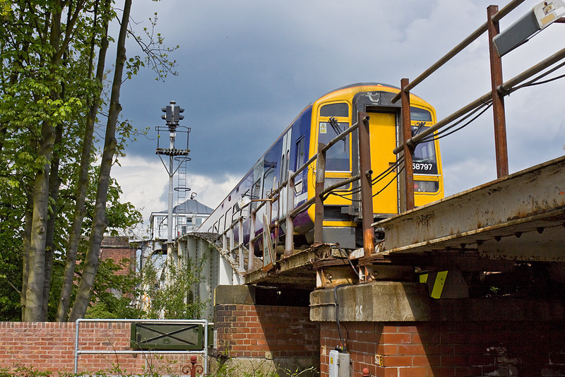 """11th May 10:  Departing from Selby 155797 is the 15.05 from Leeds to Hull.  Captured here crossing """"Ousegate"""" and onto the Swing Bridge over the River Ouse"""