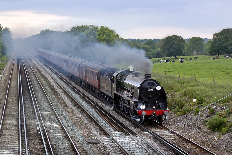 31st May 10:  Running 30 minutes late and following closely behind the Basingstoke to Waterloo stopper 'Sir Lamiel' potters up the slope from Hook to Winchfield.  30777 is returning to Victoria with the 'Swanage Belle' tour