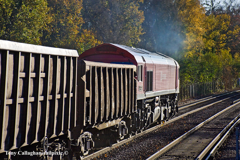 10th Nov 10:  For the 2nd time this week and this time in much better light 59206 runs west through Virginia Water.  The empty stone boxes ar going to Merehead from Sevington which is just east of Ashford in Kent