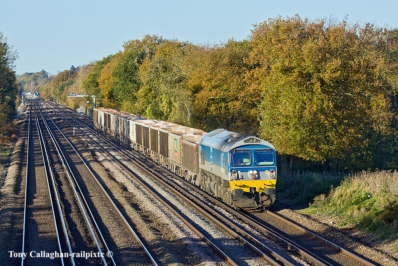10th Nov 10:  59002 wanders up the Slow line with the 05.52 (7O12) from Merehead to Woking.  Captured at Totters Lane .