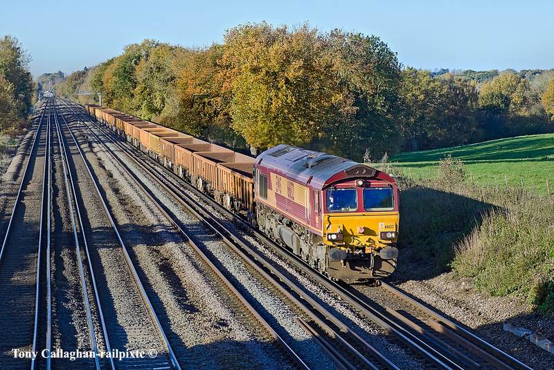 10th Nov 10:  In beautiful Autumnal light the Eastleigh to Hoo Junction departmental with a long rake of JNAs & MLAs is powered by 66132.  Seen here as it trots up the grade between Hook and Winchfield