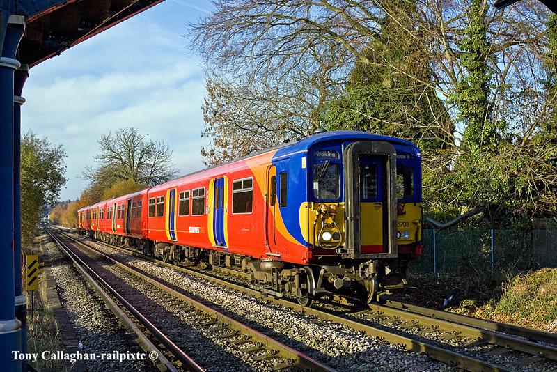 28th Nov 10:  Crossing Addlestone Moor is 455703 working 1S35 the 12.50 from Waterloo to Woking