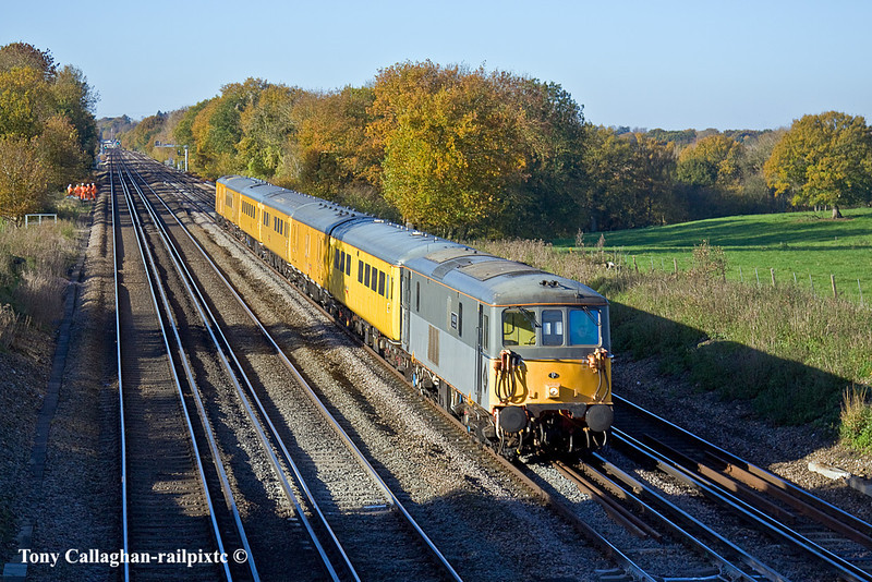10th Nov 10:  On the grade between Hook and Winchfield 73107 is caught between the shadows as, with 73138 at the rear, it works 1Q76 back towards London from Southampton