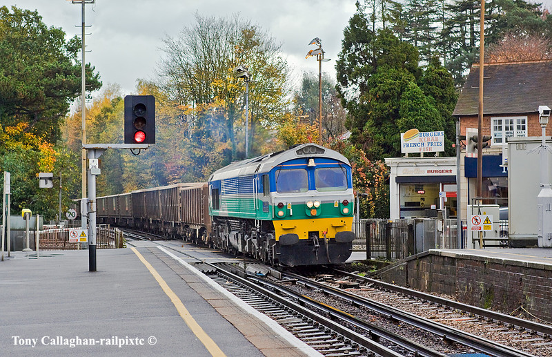 8th Nov 10:  The pioneer Class 59  No. 59001 'Yeoman Endeavour' trundles across the A30 and through Sunningdale with the occasionally run 7V67 from Sevington to Merehead