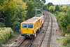 18th Oct 10:  Owned by Colas DR73908 a Plasser Theurer 08-4x4/4S-RT Switch & Crossing Tamper potters past Coxs Lock in Addlestone