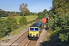 20th Oct 10:  Rounding the curve through Silchester is 66536 working 4O27 from Garston.  Mortimer church can be seen in the distance