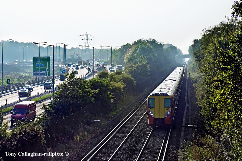 8th Oct 10:  The 16.02 from Reading to Waterloo nears Bracknell and passes the road works to make a new roundabout on the busy A329
