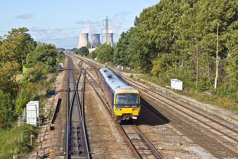 7th Oct 10:  The 09.54 from Great Malvern to Paddington,1P40, is in the hands of 166216.  Seen here crossing onto the Up Main from the Fulscot Bridge near Moreton Cutting