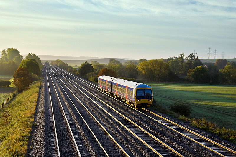 7th Oct 10:  165131 looks almost lost as it hurries towards Didcot on the Down Main Line.  Captured from the bridge at Manor Farm in Cholsey