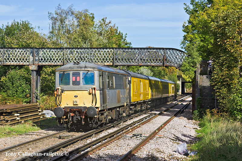 21st Oct 10:  The TRU test train TnT by 73138 ans 73107 attack the rise up to Ascot where it will reverse and return to Aldershot,  Seen here running through Bagshot