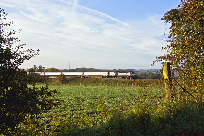 7th Oct 10:  Catching the sun at 7.33 as it passes Manor Farm at Cholsey.  43003 tails the 3.58 from Swansea to Paddington by now running 45 minutes late