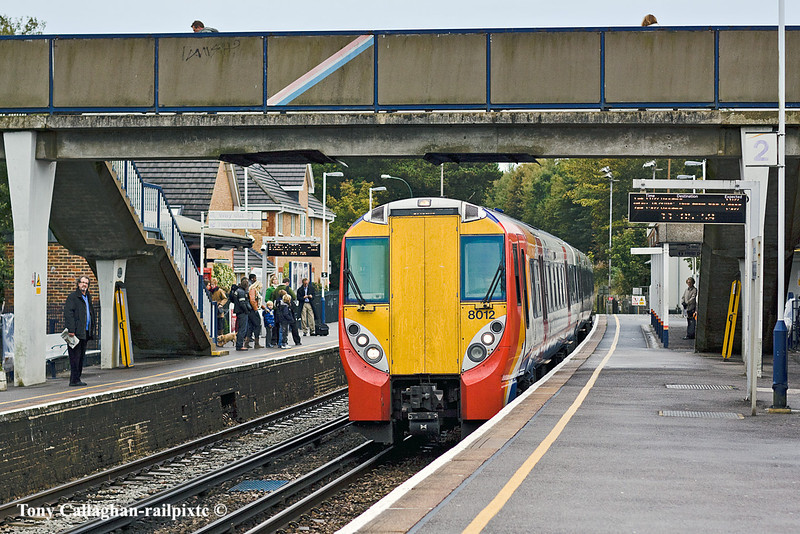 26th Oct 10:  The 10.20 from Waterloo to Reading draws into Sunningdale as a couple of commuters dash over the bridge to catch the 11.10 to Waterloo