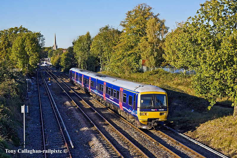 25th Oct 10:  In perfect late October light the 16.04 (2O44) from Reading to Redhill, formed of 166202, departs from Wokingham