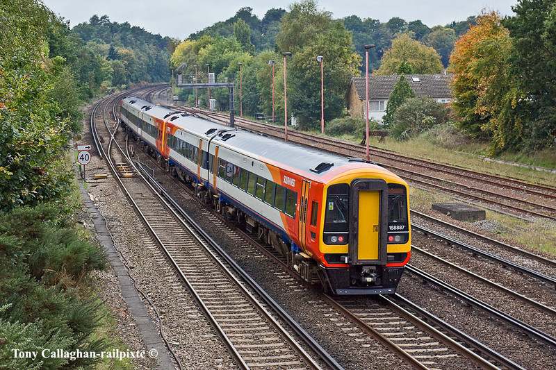 15th Oct 10:  The 11.20 from Waterloo to Exeter is tailed by 158887.  Captured here curving away from Woking