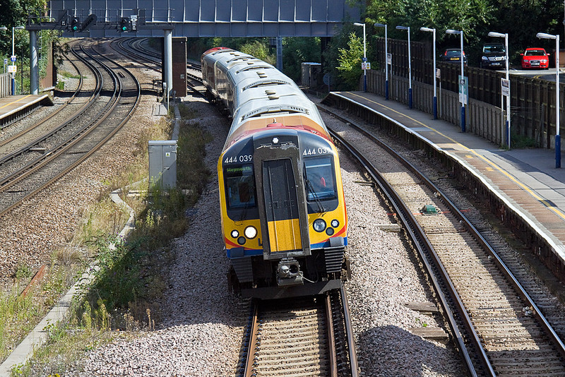 2nd Sep 10:   Leaning to the reverse curves through Farnborough is 444039 working 1W65 the 12.05 Waterloo to Weymouth