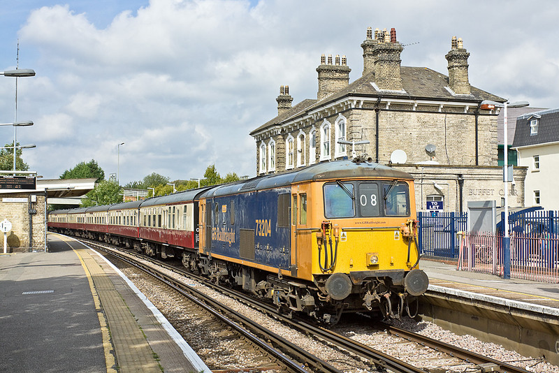 4th Sep 10:  The GBRf staff outing TnT by 73204 & 73212 runs through Chertsey.  1Z08 started in Ipswich and travelled to Portsmouth