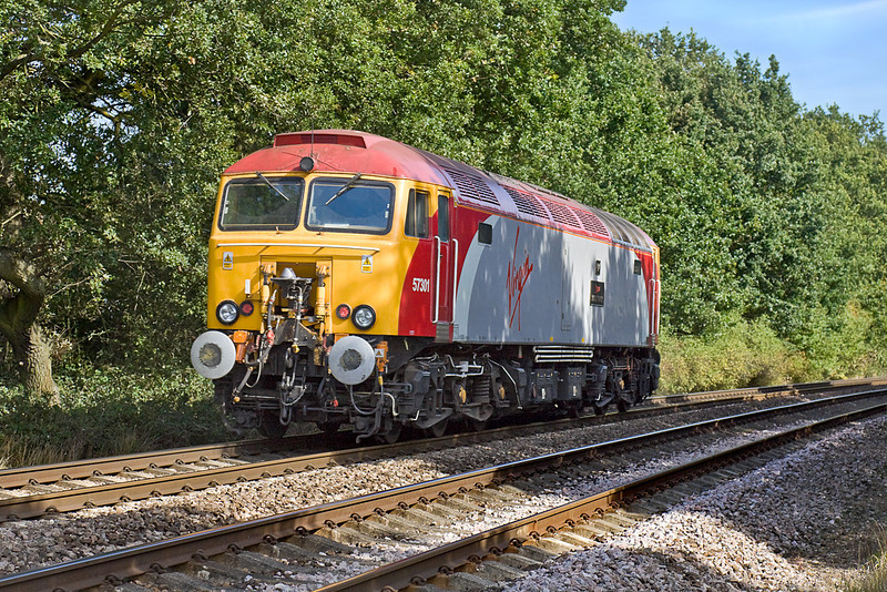 21st Sep 10:  Virgin Thunderbird 57301 crosses Great Park foot crossing, near Mortimer, on it's way to Willesden.  I would have prefered to have taken the approaching shot but it was completely blocked by the late running Birch Coppice to Southampton freightliner