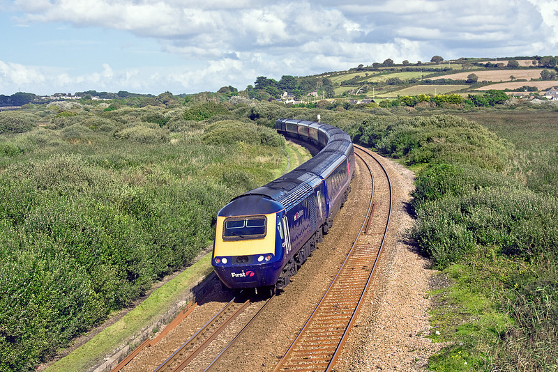 8th Sep 10:  Rounding the curve away from Marazion is 43094 on the rear of the 16.00 Penzance to Paddington