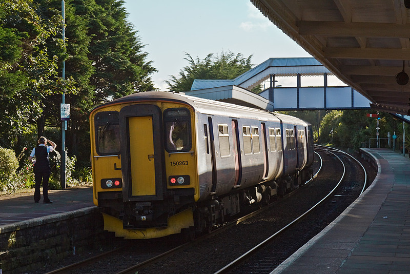6th Sep 10:  Running a few minutes late is the 16.03 from Plymouth to Penzance. The guard of 150263 checks ahead  to give the Right Away from St Erth