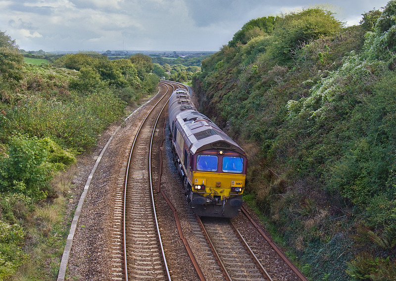 8th Sep 10:  The weekly supply of fuel for Long Rock Depot is tripped fom Fawley.  The last stage is 6C21 from Burngullow, seen here in the hands of 66167  as it passes through Angarrak