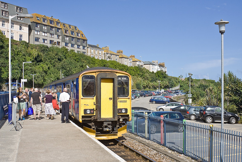9th Sep 10:  150232 has just arrived at St Ives and will form 2A18 the 11.55 non stop to St Erth.  The original platform allignment was roughly situated on the road between the parked cars