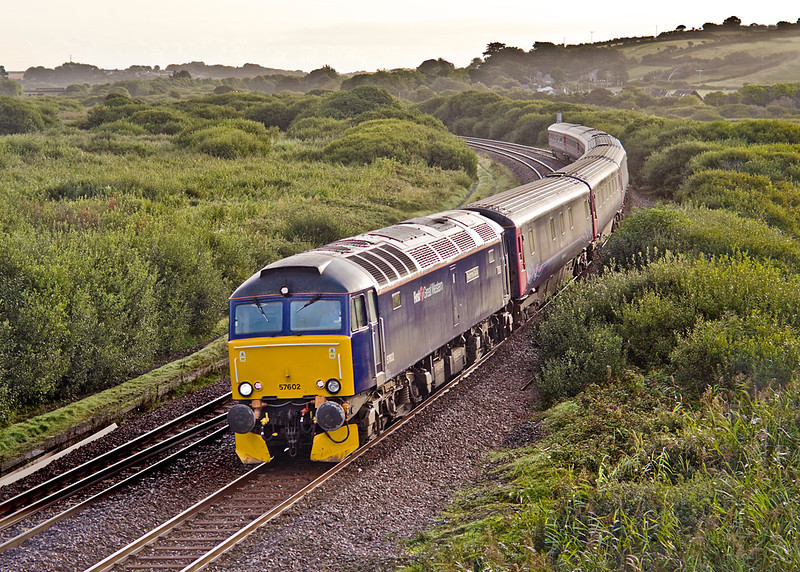 9th Sep 10:  On a golden morning 57602 rounds the curve into Marazion on the very last leg of 1C99 the Paddington to Penzance sleeper service