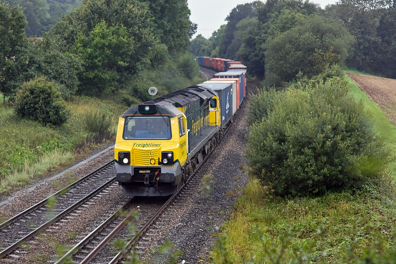 23rd Aug 11:  70007 climbs through Silchester doing it's normal duty 4M68 the 14.50 from Southampton to Birch Coppice