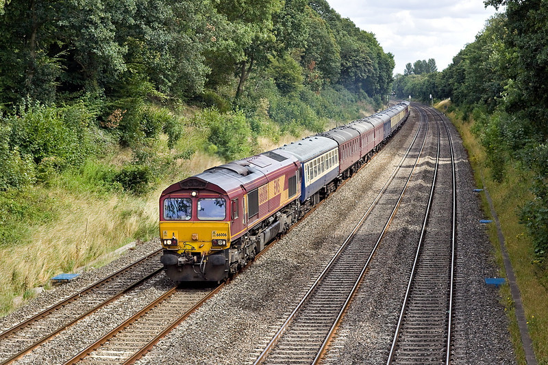 15th Aug 11:  5O61 is the Monday morning  ECS move from Wembley to Eastleigh. Today it was headed by 66006 with 67008 acting as the 'tail gunner'.  Pictured at Duffield Road in Sonning.
