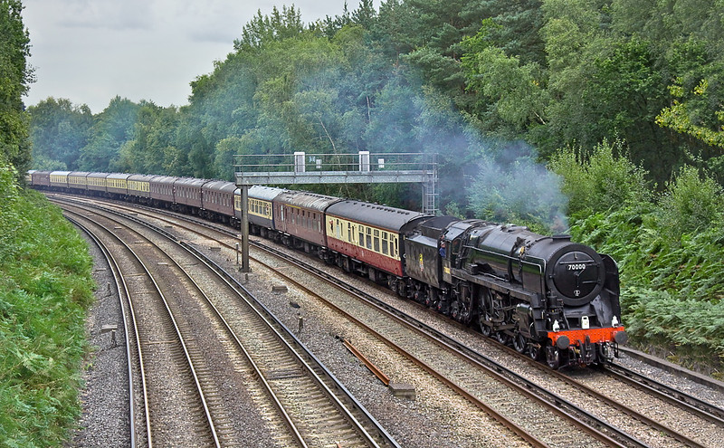 31st Aug 11:  70000 'Britannia' drifts round the corner at Piribright as the next signal is at red.  1Z34 'The Cathedrals Express' is running from Southend to Salisbury.