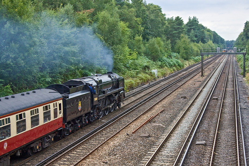 31st Aug 11:  70000 'Britania' is working the day's Cathex from Southend to Salisbury.  The crew are keeping a shapt watch on the signals as trains are bening passed through with the lights at red.