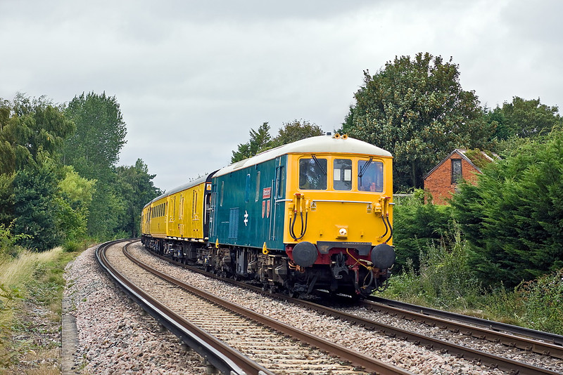 16th Aug 11:  73201 'Broadlands' TnT 73138 climbs away from Wokingham.  1Q84 started from Grove Park and will complete the day at Woking